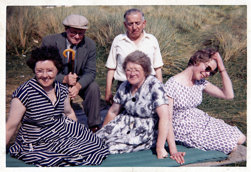 Enjoying a day on the Enniscrone beach. Dad is wearing a cap and Joan has a hand to her hair.1965